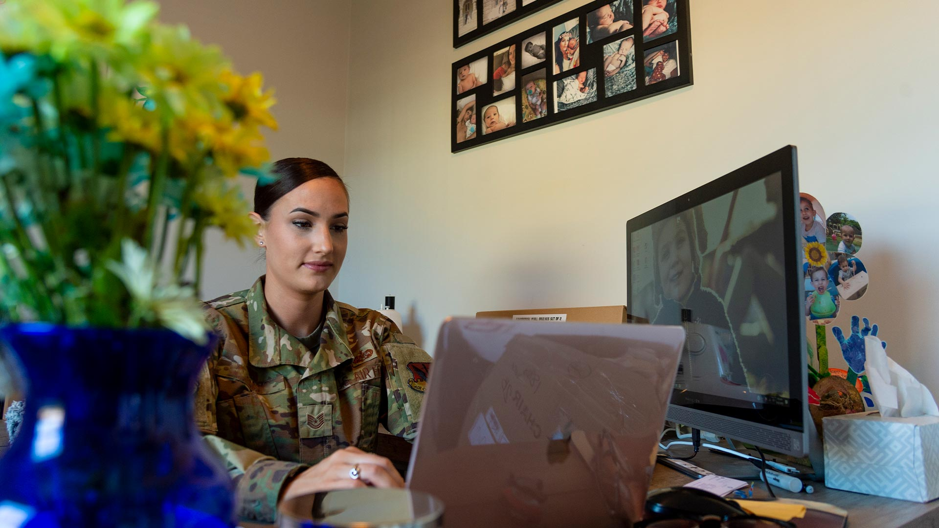 Military mom working on laptop