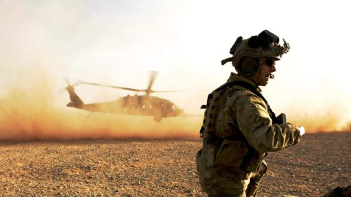 service member and helicopter