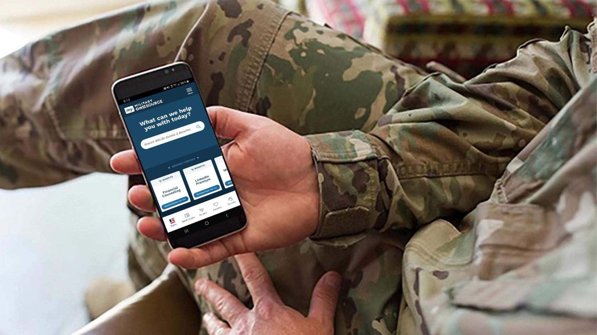Service member showing Military OneSource mobile