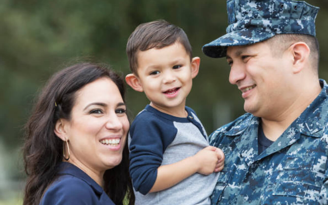A service member with son and wife