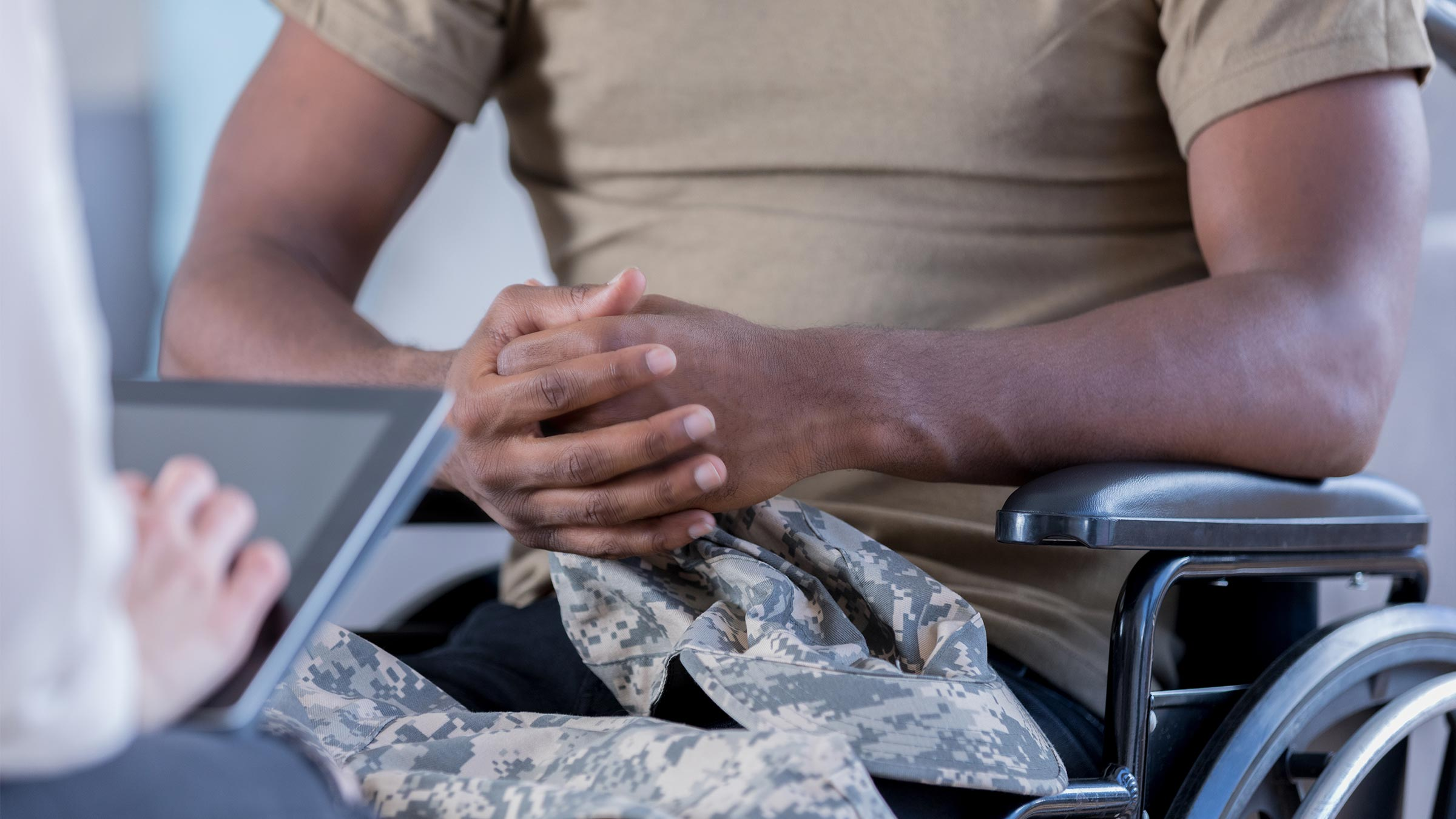 Soldier in wheel chair holding a tablet