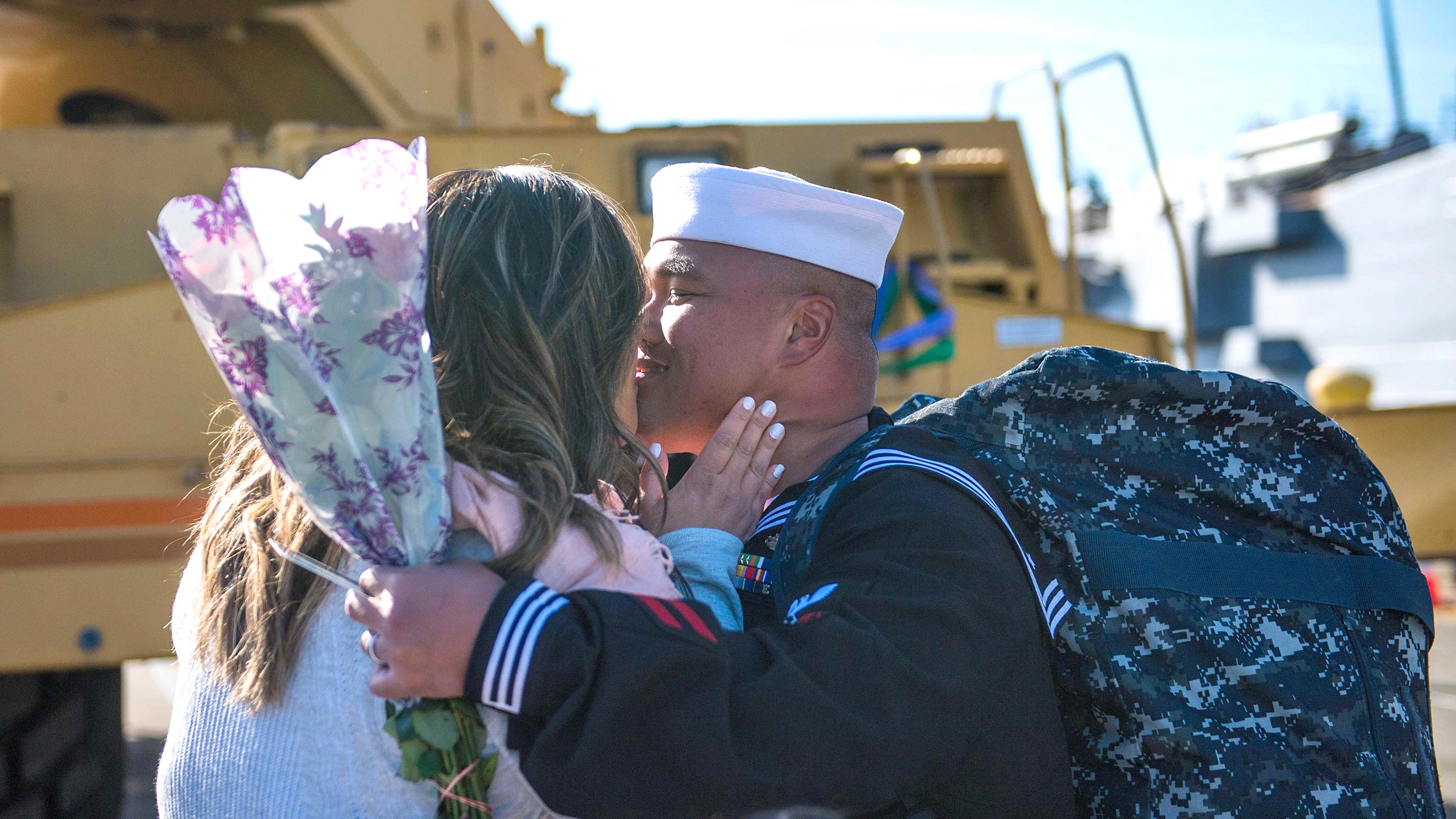 Spouse welcomes returning service member with flowers