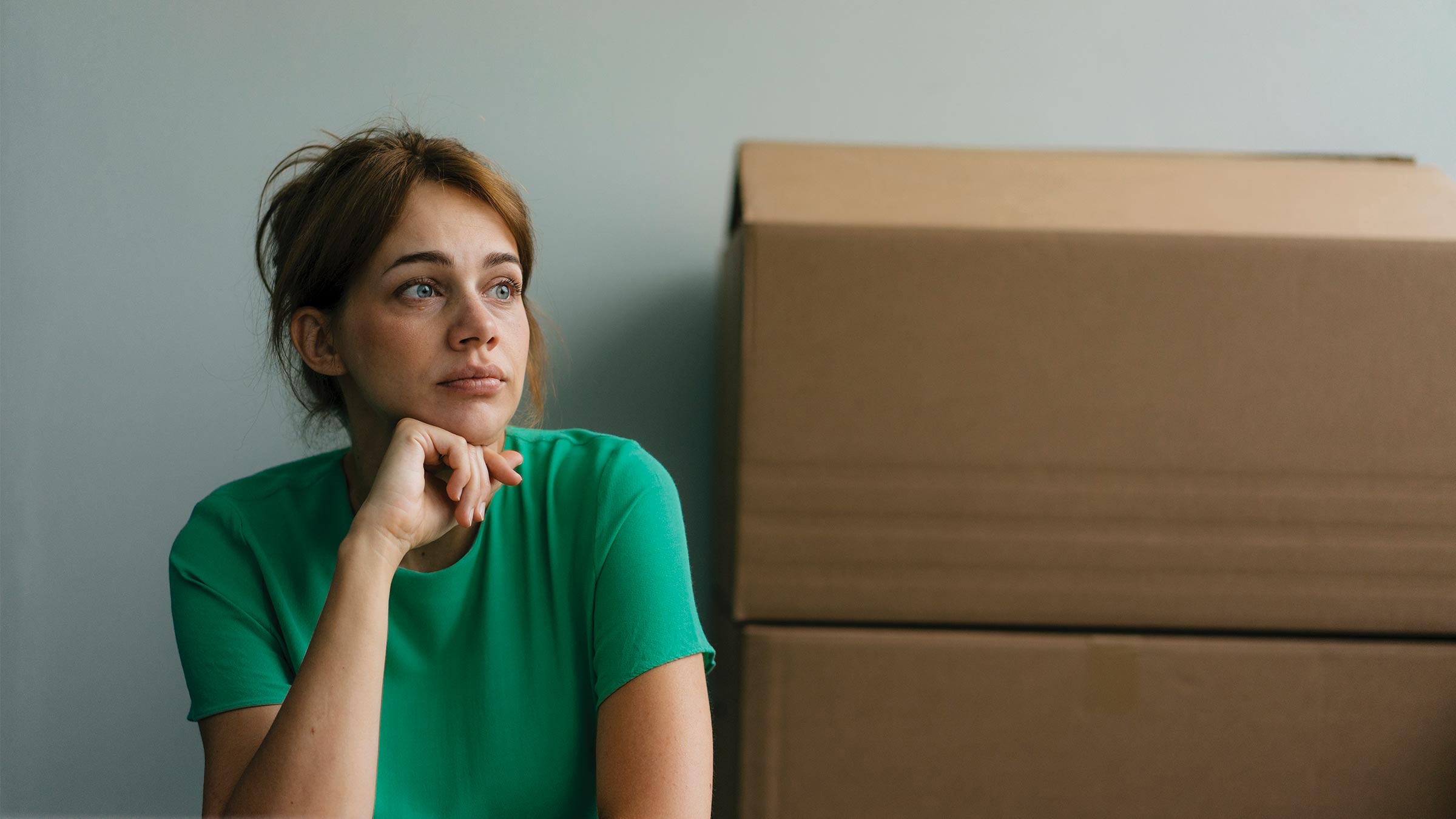 Woman sitting with moving boxes
