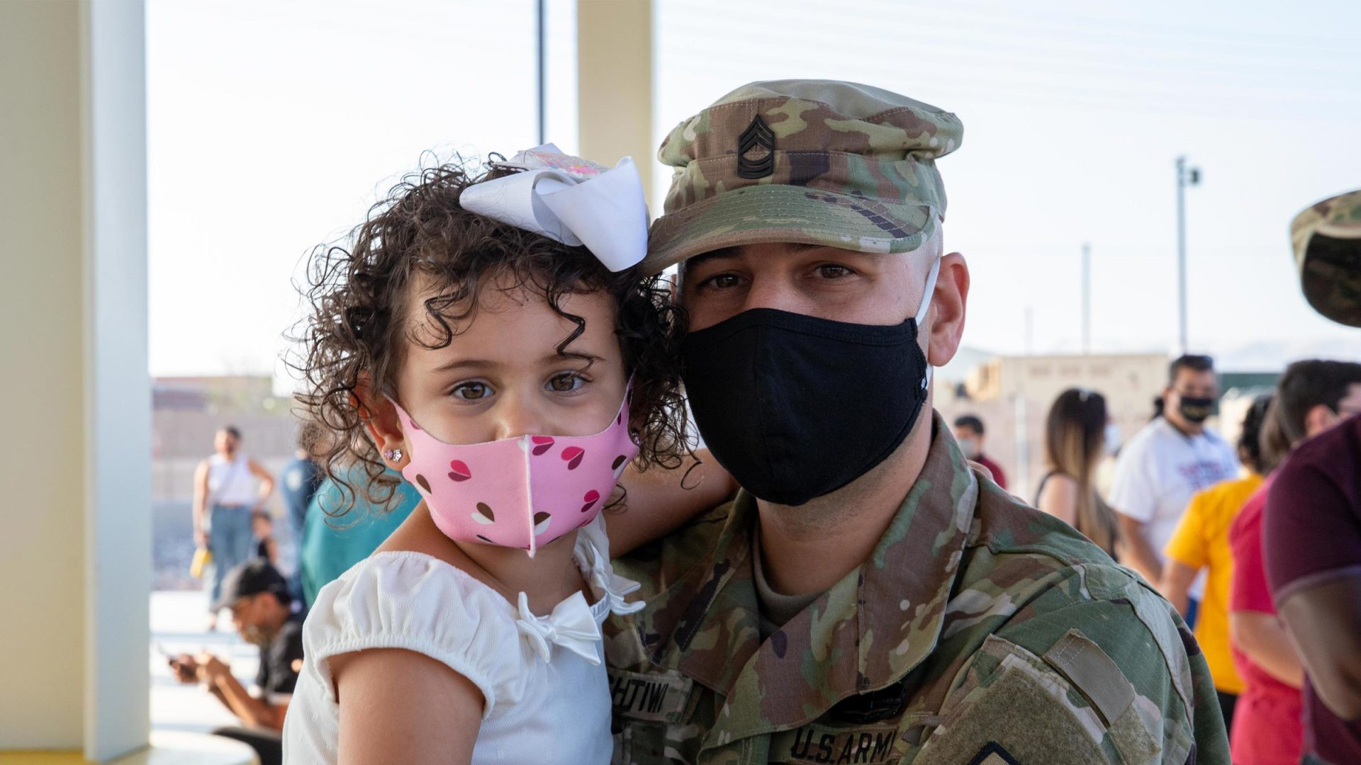 Military father holding daughter