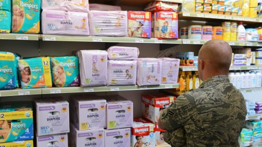 Military father shopping for diapers