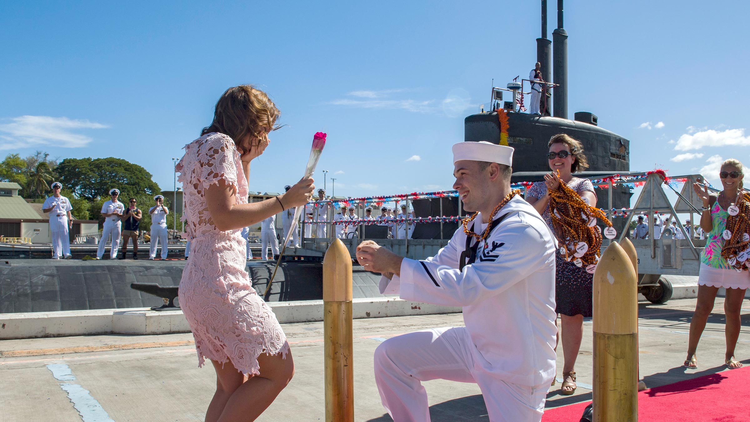 Sailor proposes to his girlfriend during a homecoming arrival