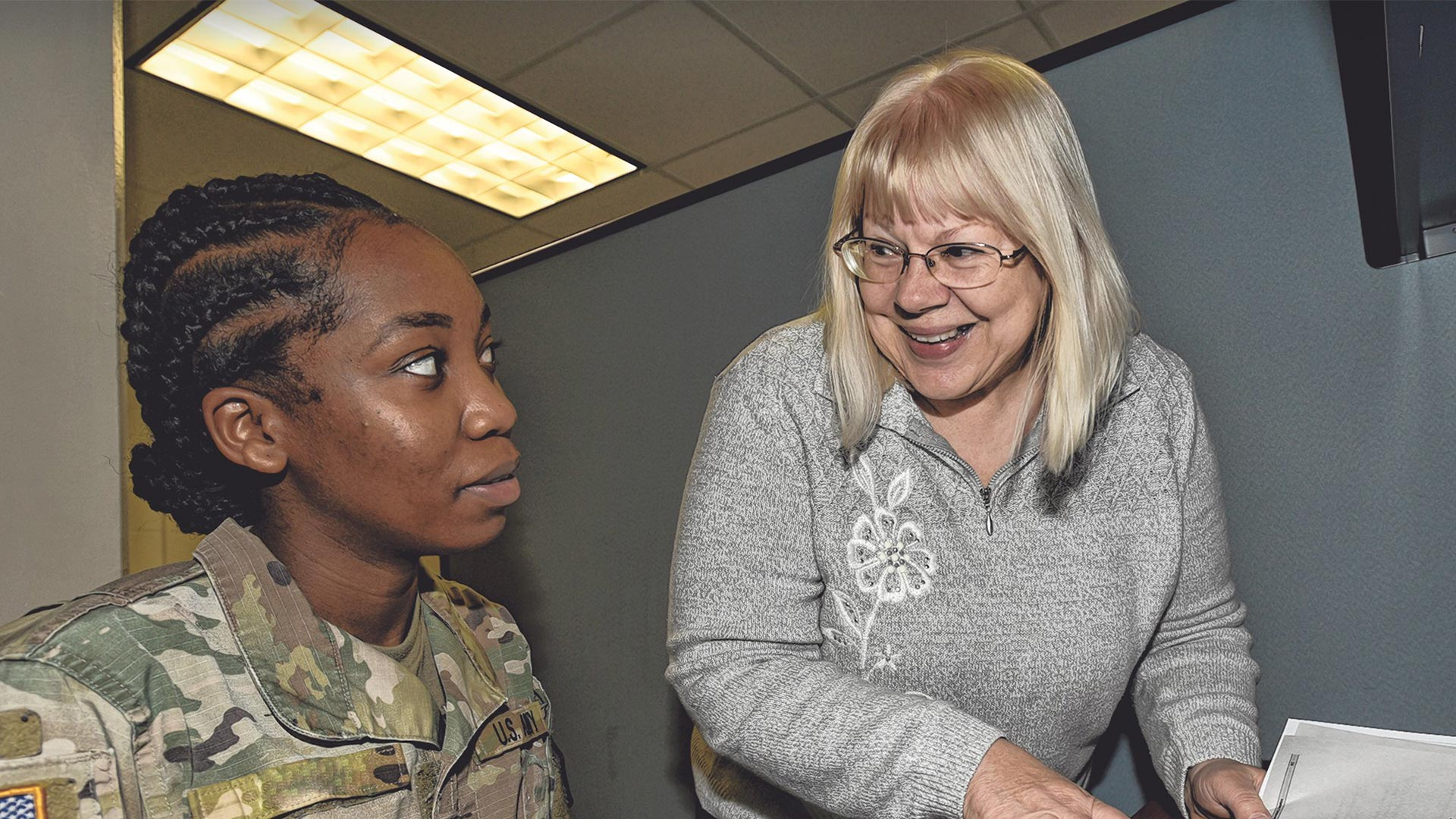 Service member meets with a volunteer
