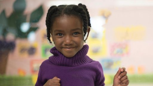 Smiling child in purple sweater