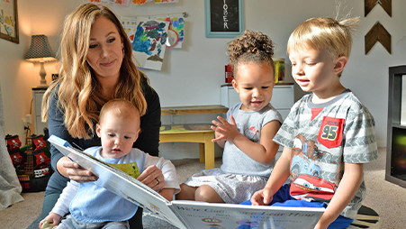 Woman reading to multiple children