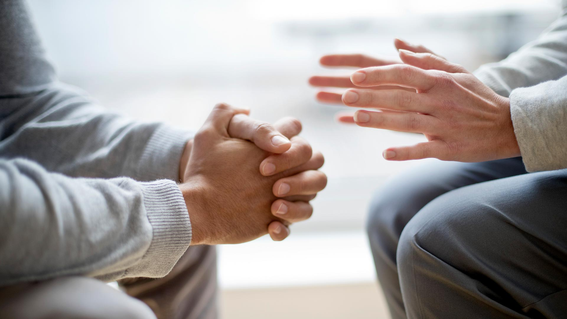 close up of hands during a conversation