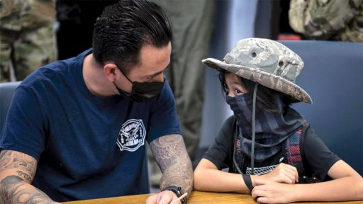 Service member and daughter wear masks