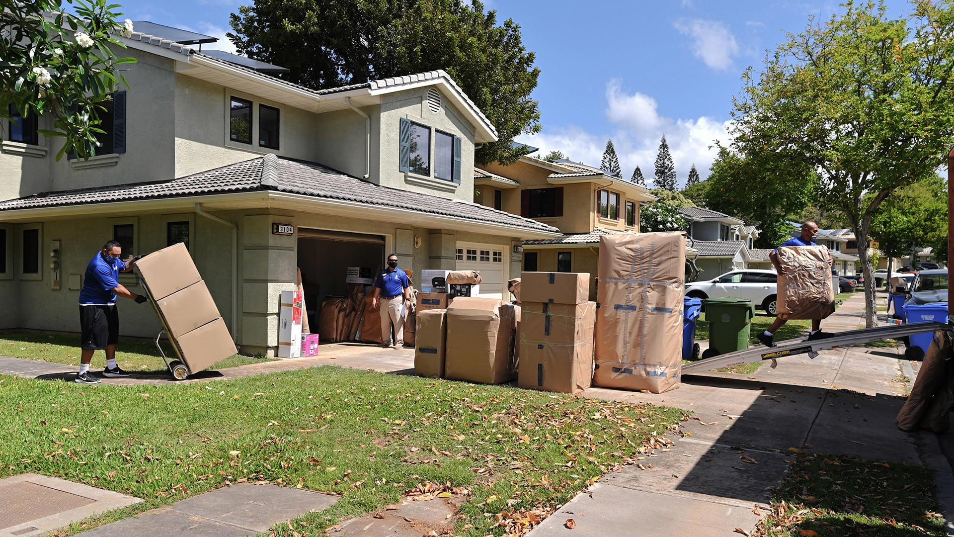 Movers moving family into new home