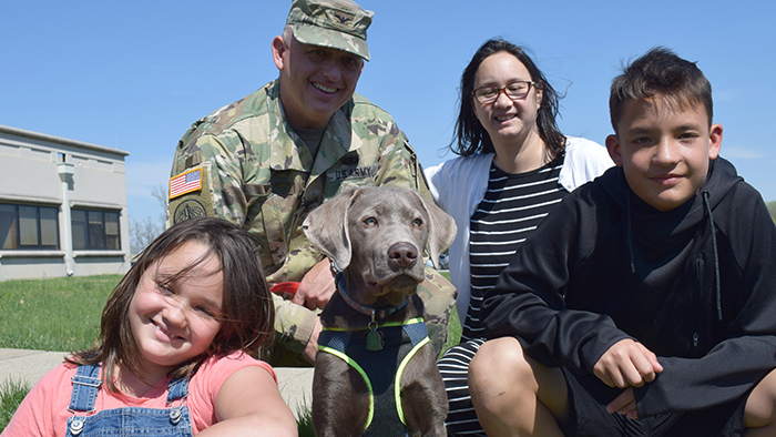 service member with family