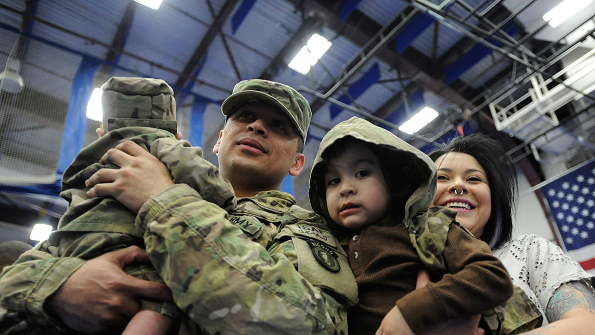 A smiling military family of four