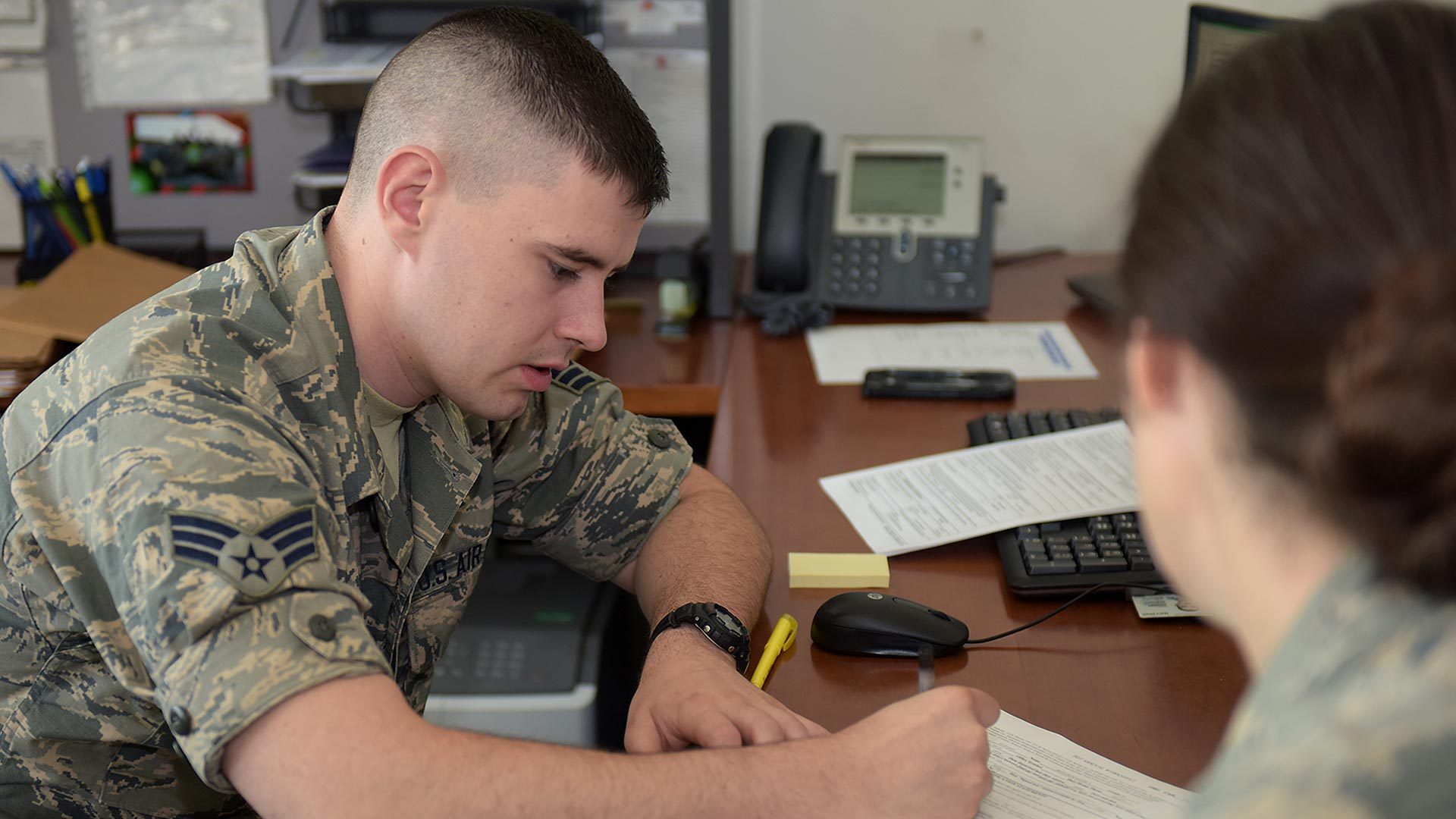 Airman assisting with PCS claim forms