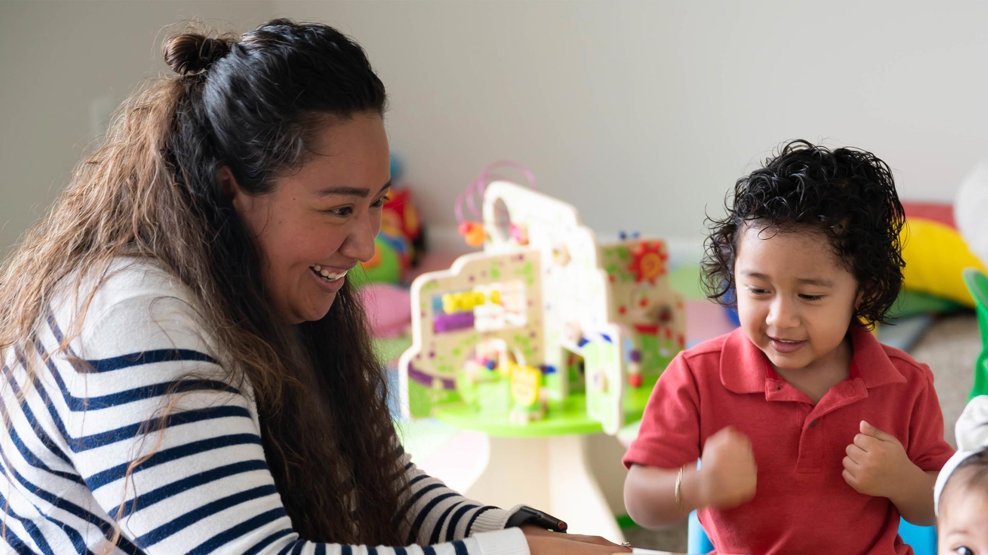 A woman provides child care in home