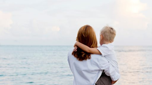 Mother and son looking at horizon