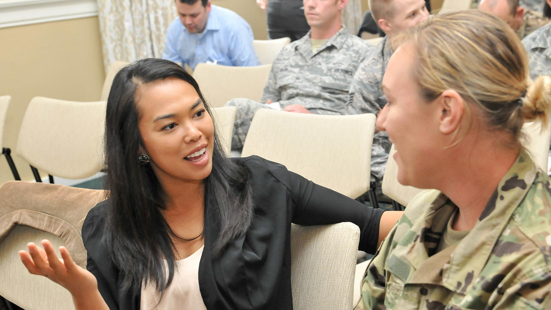woman chatting with service member