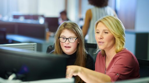 Counselor and student working on computer