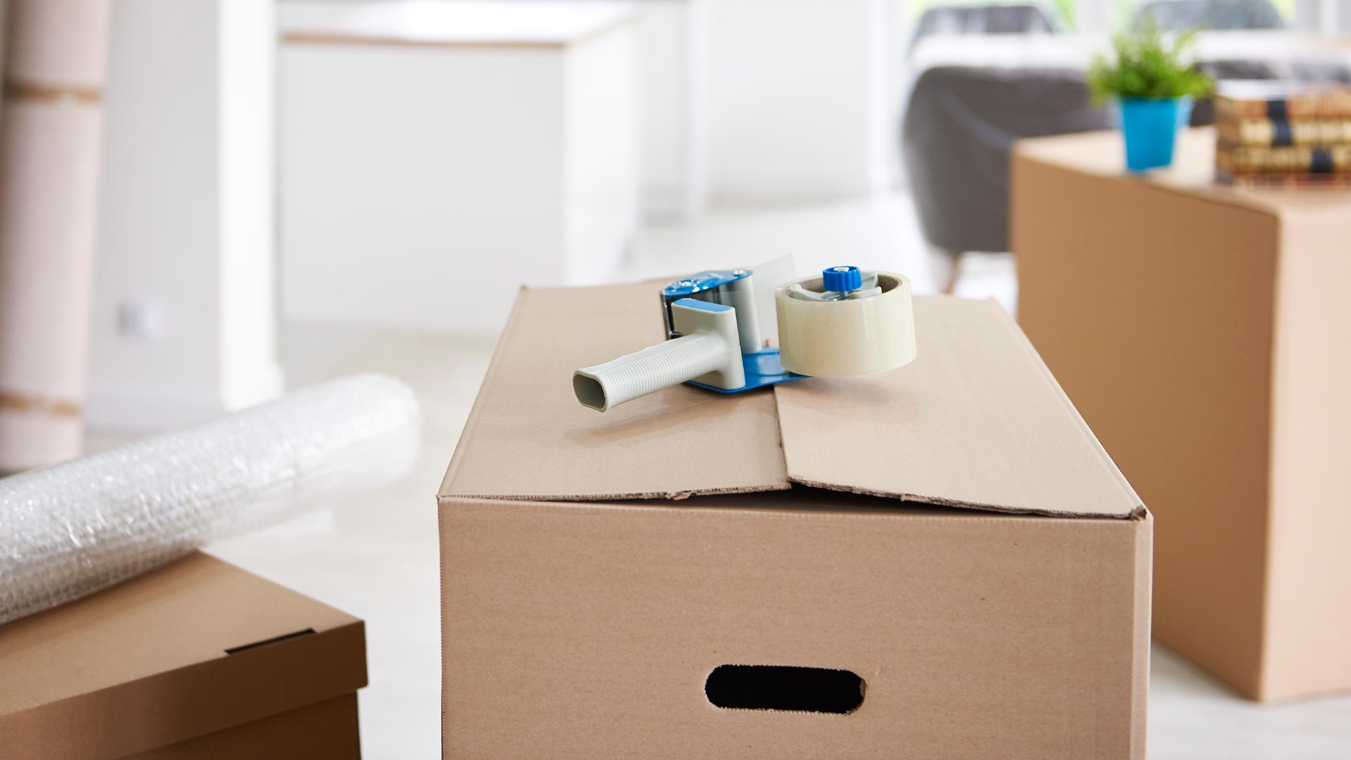 Packed moving box with tape and bubble wrap