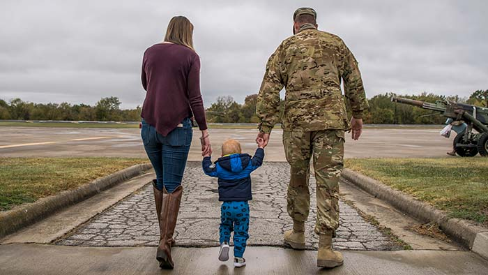 family walking hand-in-hand